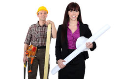 Tradesman admiring a female engineer Stock Photos