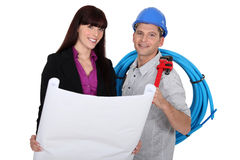 Tradesman and architect. Working together Stock Image