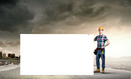 Tradesman with banner Stock Images