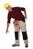 Tradesman bending over Royalty Free Stock Photo