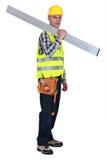 Tradesman carrying a girder Stock Image