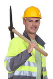 Tradesman carrying a pickaxe Royalty Free Stock Photos