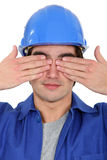 Tradesman covering his eyes Stock Photos
