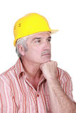 Tradesman deep in thought Royalty Free Stock Image