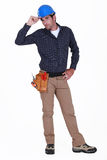 Tradesman giving a salute Stock Photography