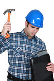 Tradesman hitting his laptop Royalty Free Stock Photos