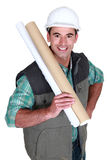 Tradesman holding building drawings Royalty Free Stock Image