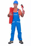Tradesman holding corrugated tubing Stock Photography