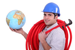 Tradesman holding a globe Royalty Free Stock Photography