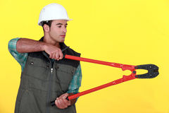 Tradesman holding large clippers Royalty Free Stock Photography