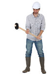 Tradesman holding a mallet. With both hands Royalty Free Stock Photography