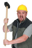 Tradesman holding a mallet Royalty Free Stock Photos