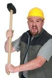 Tradesman holding a mallet. An angry tradesman holding a mallet Royalty Free Stock Photos