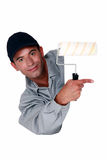 Tradesman holding a paint roller Royalty Free Stock Photo