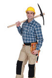 Tradesman holding a pickax Royalty Free Stock Images