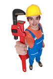 Tradesman holding a pipe wrench Stock Photography