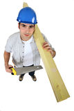 Tradesman holding planks Stock Images