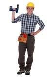 Tradesman holding a screwdriver. Tradesman holding an electric screwdriver Royalty Free Stock Photos