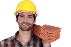 Tradesman holding shingles Royalty Free Stock Photography