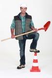 Tradesman holding a spade Stock Photography