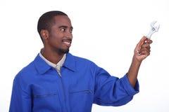 Tradesman holding spanner, Royalty Free Stock Image