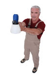 Tradesman holding a spray gun Stock Image