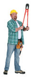 Tradesman holding up  clippers Royalty Free Stock Photo