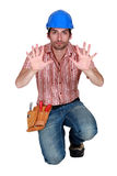 Tradesman holding up his hands Stock Photo