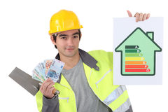 Tradesman holding up money Stock Photography