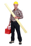 Tradesman holding a wooden plank Stock Images