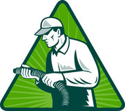 Tradesman home insulation technician with hose. Illustration of a tradesman home insulation technician holding a hose viewed from side set inside triangle with Stock Images