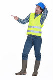 Tradesman laughing. At something in the distance Royalty Free Stock Photos