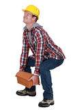 Tradesman lifting a heavy load Stock Photos