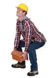Tradesman lifting a heavy load Stock Photos