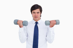 Tradesman lifting weights Stock Photo
