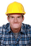 Tradesman making a face. Tradesman making a silly face Royalty Free Stock Images