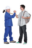 Tradesman making a pact Royalty Free Stock Images