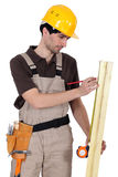 Tradesman measuring wood Stock Photo
