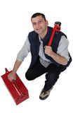 Tradesman with a pipe wrench Royalty Free Stock Image