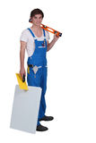 Tradesman posing with his tools Royalty Free Stock Photos