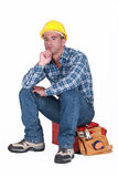 Tradesman sitting on toolchest Stock Photos