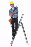 Tradesman standing on a stepladder Royalty Free Stock Photo