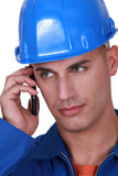 Tradesman talking on his mobile Stock Image