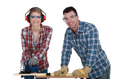 Tradesman training his apprentice Royalty Free Stock Image
