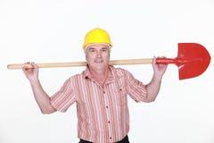 Tradesman trzyma łopatę Obrazy Royalty Free
