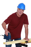 Tradesman using a jigsaw Royalty Free Stock Photography
