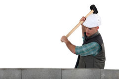 Tradesman using a mallet Stock Images