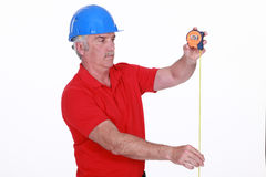 Tradesman using a measuring tape Royalty Free Stock Images