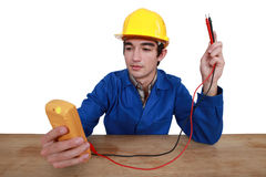 Tradesman using a multimeter Stock Photo