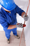 Tradesman using a tool. To shape a cooper tube royalty free stock photo